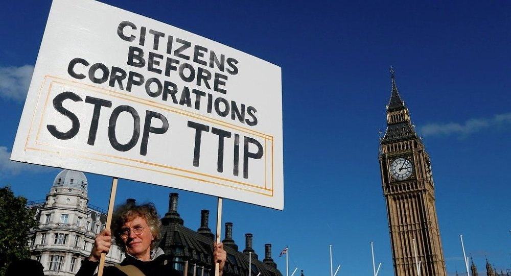 A demonstrator holds a banner in Parliament Square in London, Saturday, Oct. 11, 2014.