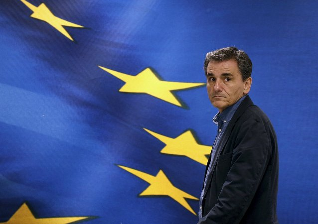 Newly-appointed Finance Minister Euclid Tsakalotos arrives at the Finance Ministry for a handover ceremony in Athens, Greece