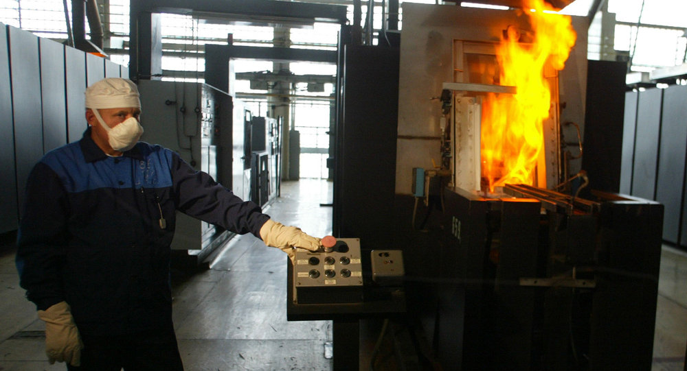 Worker operates a machine for production of uranium tablets for nuclear power reactors at the Ulba Metal plant in the city of Ust-Kamenogorsk in eastern Kazakhstan.