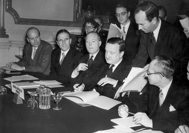 In this Feb. 27, 1953 file photo, the German Debts Agreement is signed in London. Though Germany is resisting Greece's pleas for some relief, it should know better than most what it can achieve.
