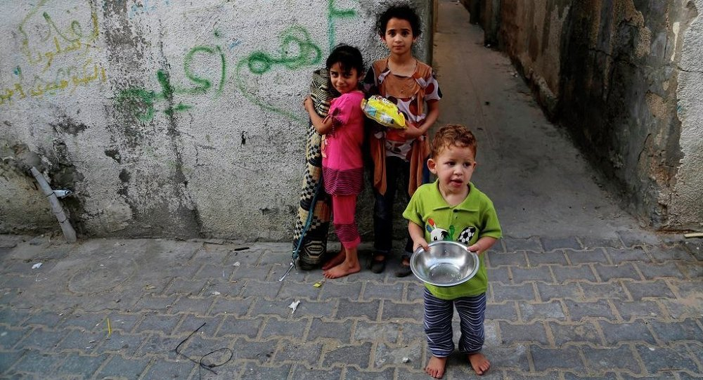 Palestinian children pose for a photo in Jebaliya refugee camp in the northern Gaza Strip, Thursday, May 14, 2015.