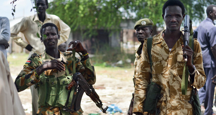 June 24, 2015, South Sudanese government soldiers patrol in Bentiu town, South Sudan. South Sudan's army has burned people alive, raped and shot girls, and forced tens of thousands from their homes