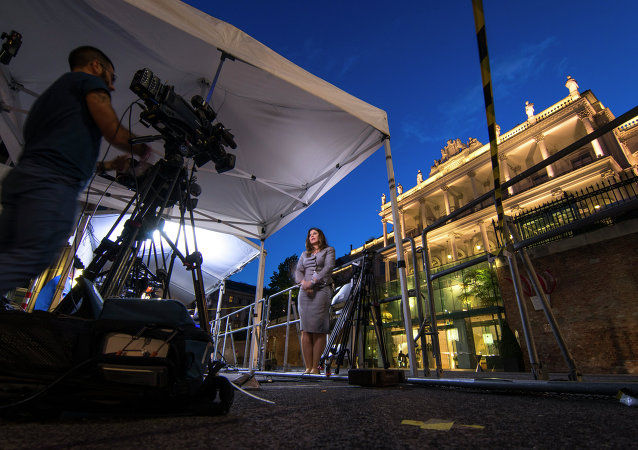 Sky News television crew make their report outside the Palais Coburg Hotel where the Iran nuclear talks meetings are being held in Vienna, Austria on July 9, 2015