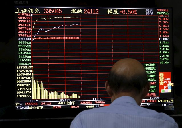An investor looks at a computer screen showing stock information at a brokerage house in Shanghai, China, July 10, 2015
