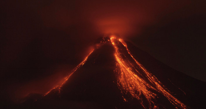 Lava flows down the banks of the Colima Volcano, also known as the Volcano of Fire, near the town of Comala, Mexico, Friday, July 10, 2015