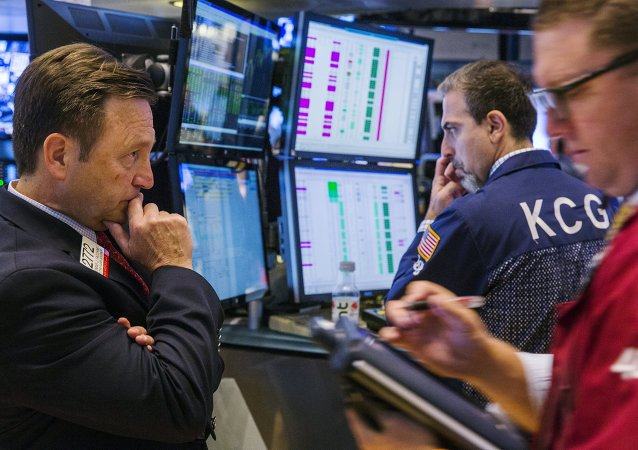A New York Stock Exchange official monitors the action on the floor of the exchange shortly after the opening bell in New York, July 9, 2015