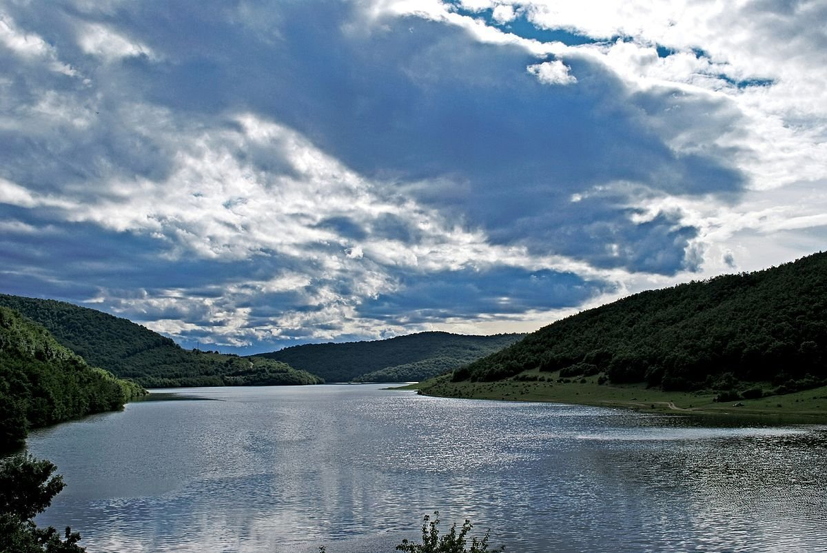 Badovac Lake or Badovc Lake is an artificial lake in Kosovo. It is located south-east of the capital city of Pristina in the Goljak mountains and in the Kosovo Plain. It provides Pristina and the surrounding towns with water