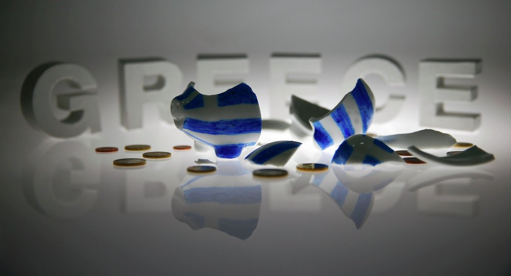 A broken piggybank painted in the colours of the Greek flag lies amongst various euro coins in front of letters spelling the word 'GREECE' in this picture illustration taken in Berlin, Germany June 30, 2015