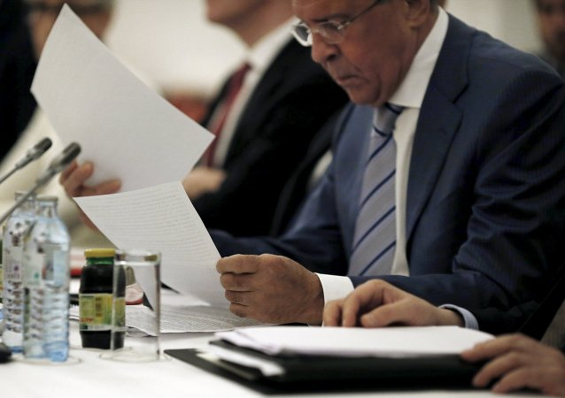 Russian Foreign Minister Sergei Lavrov reads documents during a meeting with foreign ministers and delegations from Germany, France, China, Britain, the US and the European Union at a hotel in Vienna, Austria July 13, 2015