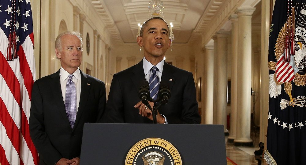 U.S. President Barack Obama speaks with Vice President Joe Biden at his side as he delivers a statement about the nuclear deal reached between Iran and six major world powers during an early morning address to the nation from the East Room of the White House in Washington, July 14, 2015