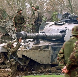 British 'tankers' from the fourth royal armoured brigade with Challenger tanks hold their position near Skopje airport 27 March 1999.