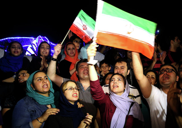 Jubilant Iranians sing and wave Iran flags during street celebrations following a landmark nuclear deal, in Tehran, Iran, Tuesday, July 14, 2015