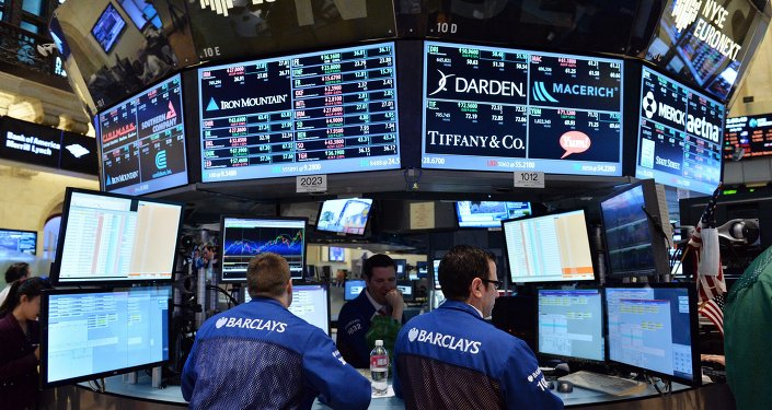 Stock specialists at the Barclays post work on the floor of the New York Stock Exchange just after the closing bell on July 3, 2013 in New York