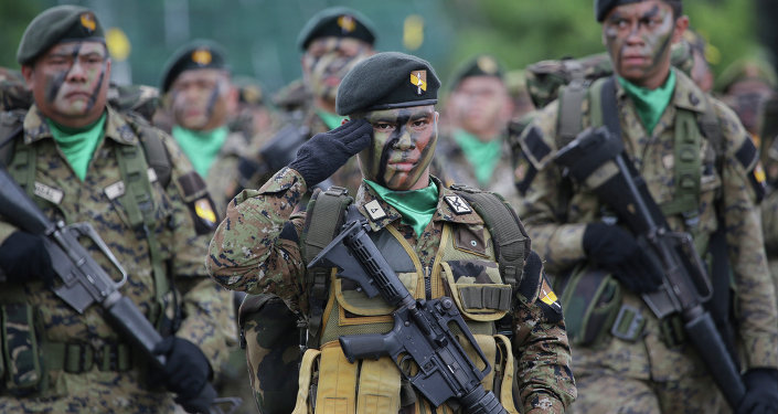 Philippine troopers participate in ceremonies on the 79th anniversary of the Armed Forces of the Philippines (AFP) at Camp Aguinaldo military headquarters in suburban Quezon city, north of Manila, Philippines on Thursday, Dec. 18, 2014