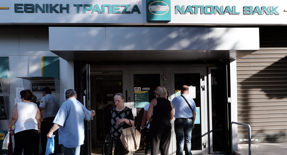 People wait outside of a national bank branch in Athens on July 20, 2015