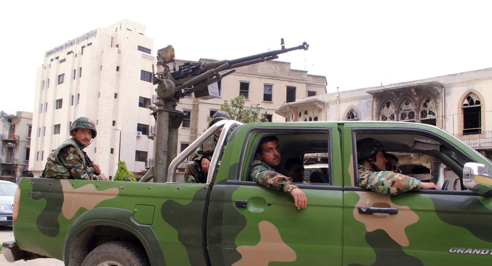 Syrian soldiers patrol Homs streets.