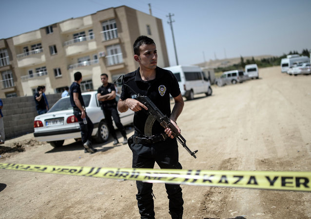 Turkish police stand near a building, where two police officers were found shot dead at their home on July 22, 2015 in the Turkish town of Ceylanpinar on the border with Syria.