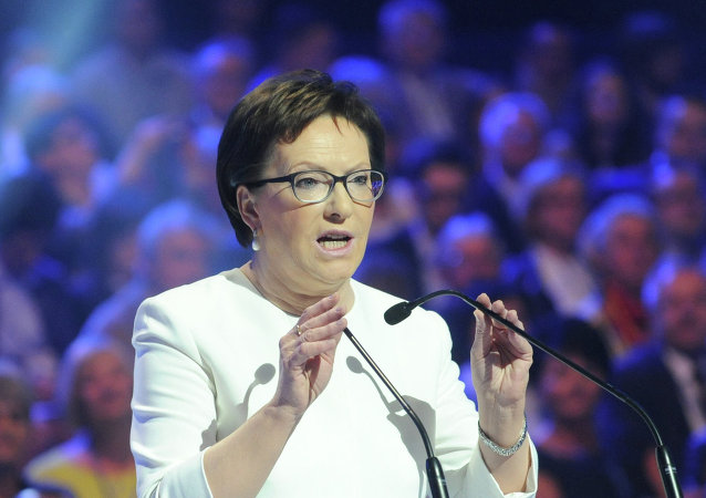 Polish Prime Minister Ewa Kopacz speaks to supporters during the convention of the ruling Civic Platform party ahead of the fall parliamentary elections, in Warsaw, Poland.
