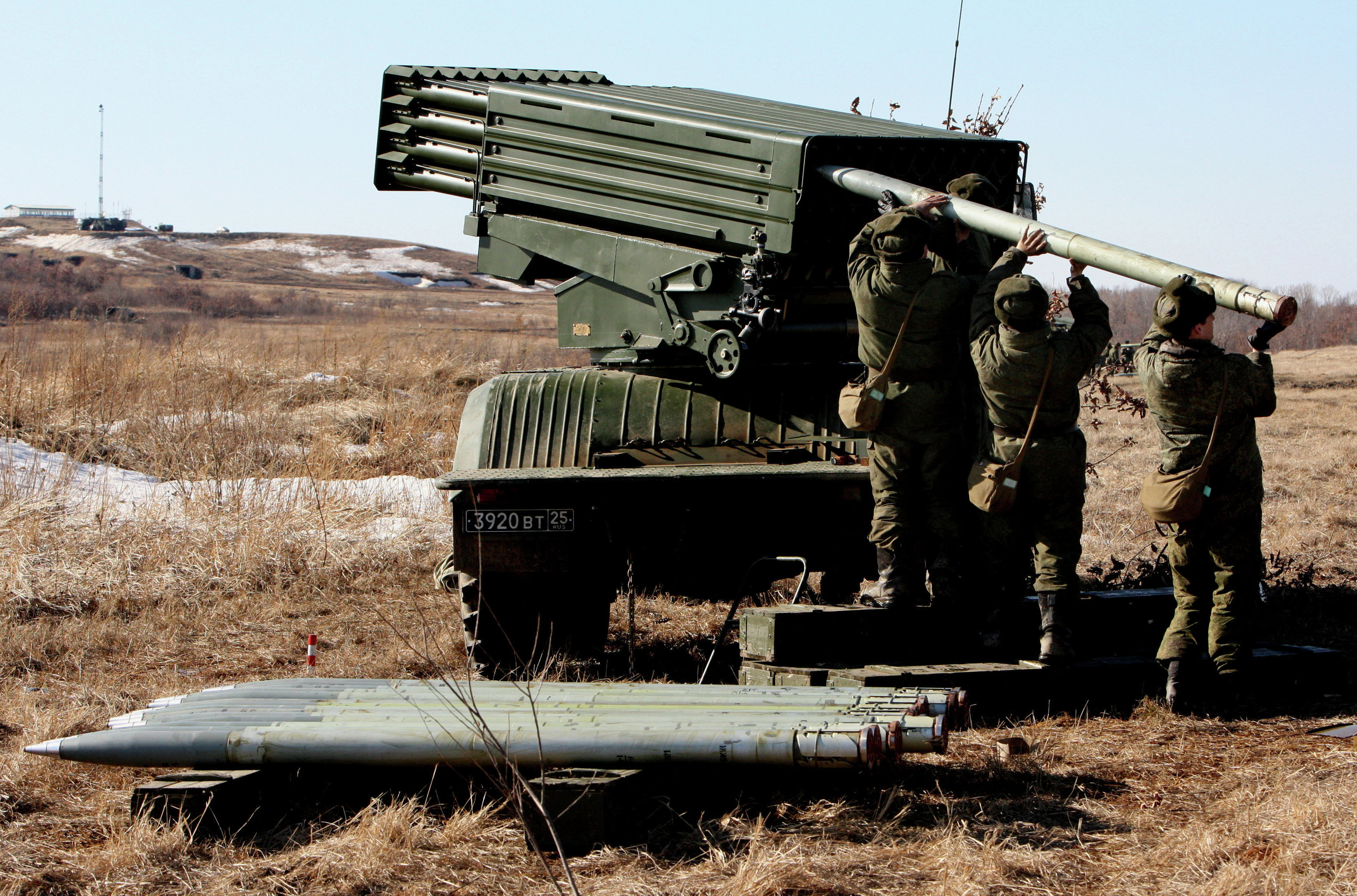 Troops load a Tornado multiple launch rocket system during the artillery drill of the 5th Army at Sergeyevsky base, Russia's Primorye Territory
