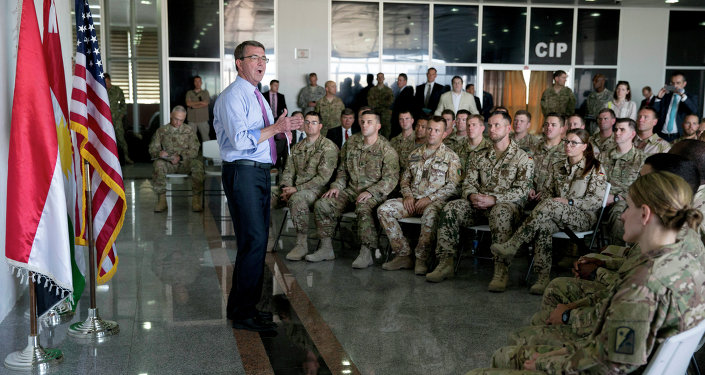 US Defence Secretary Ashton Carter (C) talks to multinational troops at the Arbil International Airport in the capital of the autonomous northern Iraqi region on July 24, 2015