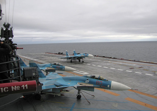 The Su-33s are seen aboard the Admiral Kuznetsov aircraft-carrying heavy cruiser. file photo.