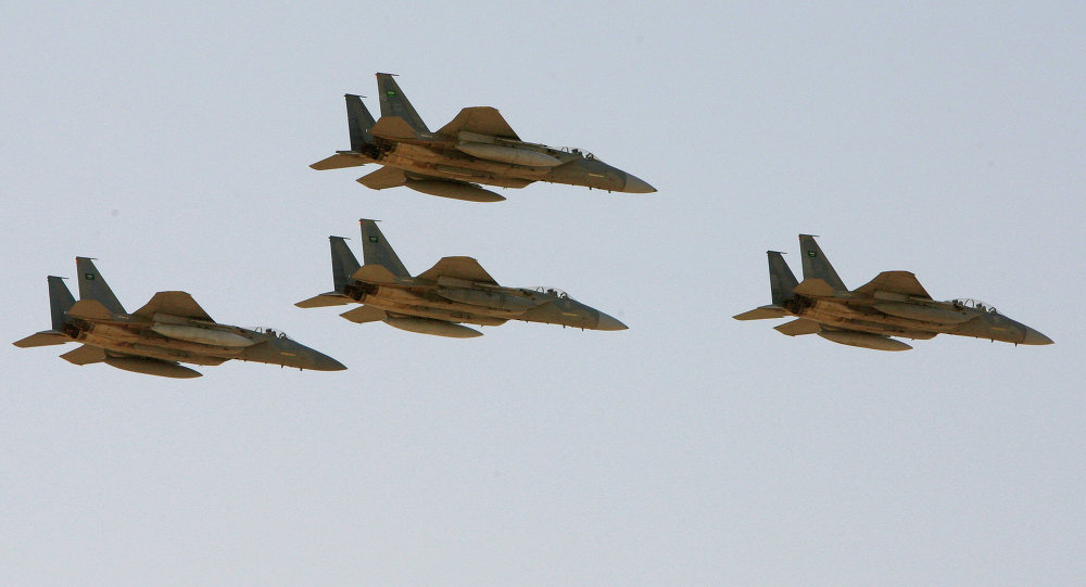 F-15 warplanes of the Saudi Air Force fly over the Saudi Arabian capital Riyadh during a graduation ceremony at King Faisal Air Force University