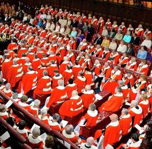 Britain's Queen Elizabeth, rear centre left, delivers her speech at the State Opening of Parliament, in the House of Lords in London Wednesday May 8, 2013.