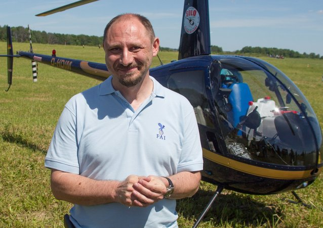 Sergei Ananov, a pilot of the Robinson R22 Solo helicopter, before heading for an around-the-world trip at the second gathering of helicopter sports enthusiasts Vertoslet at Shevlino airfield