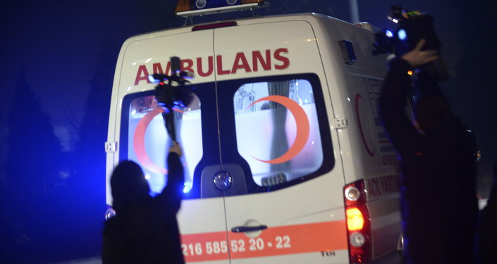 People film as an ambulance drives out of the airport in Istanbul on February 7, 2014