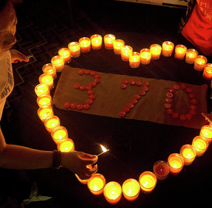 Relatives of Chinese passengers on board the Malaysia Airlines Flight MH370 light candles in a prayer room in Beijing, China, Friday, April 4, 2014.