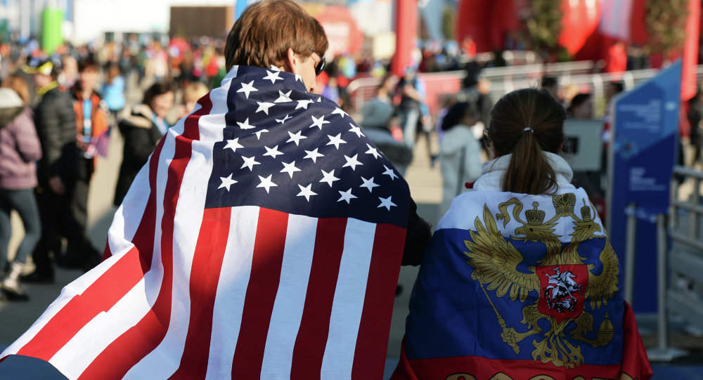 People wearing national flags of the US and Russia