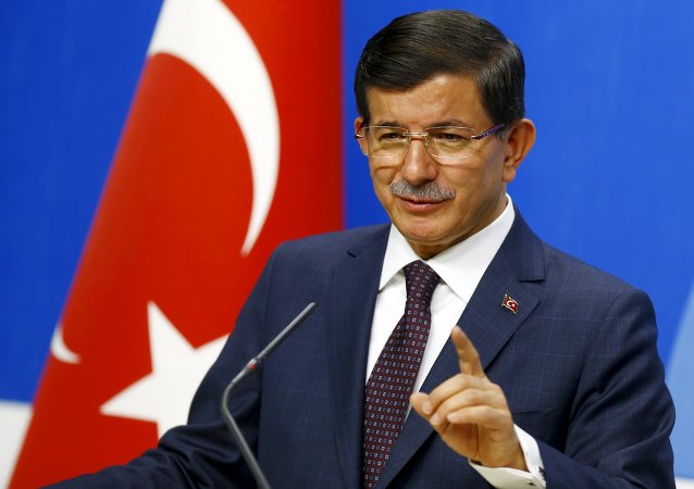 Turkey's Prime Minister Ahmet Davutoglu speaks during a news conference at his ruling AK Party (AKP) headquarters in Ankara, Turkey, July 13, 2015