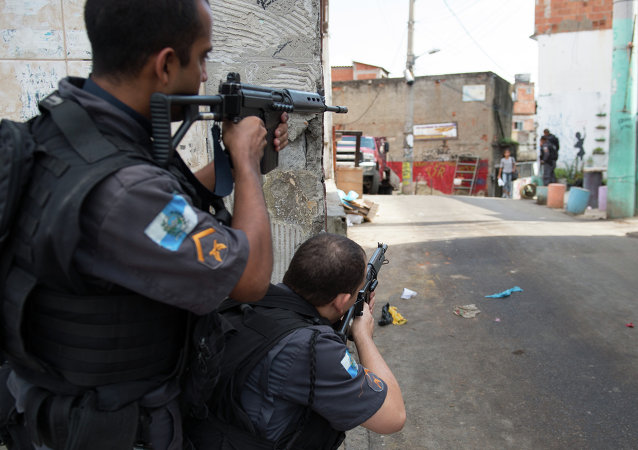 Militarized police personnel patrol the Chuveirinho favela after an exchange of fire between traffickers and police in the Alemao shantytown complex in Rio de Janeiro, Brazil, on March 24 , 2015