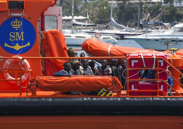 African migrants rest on board a Spanish rescue boat after arriving at Arguineguin port in the Canary Island Gran Canaria, Spain, July 13, 2015