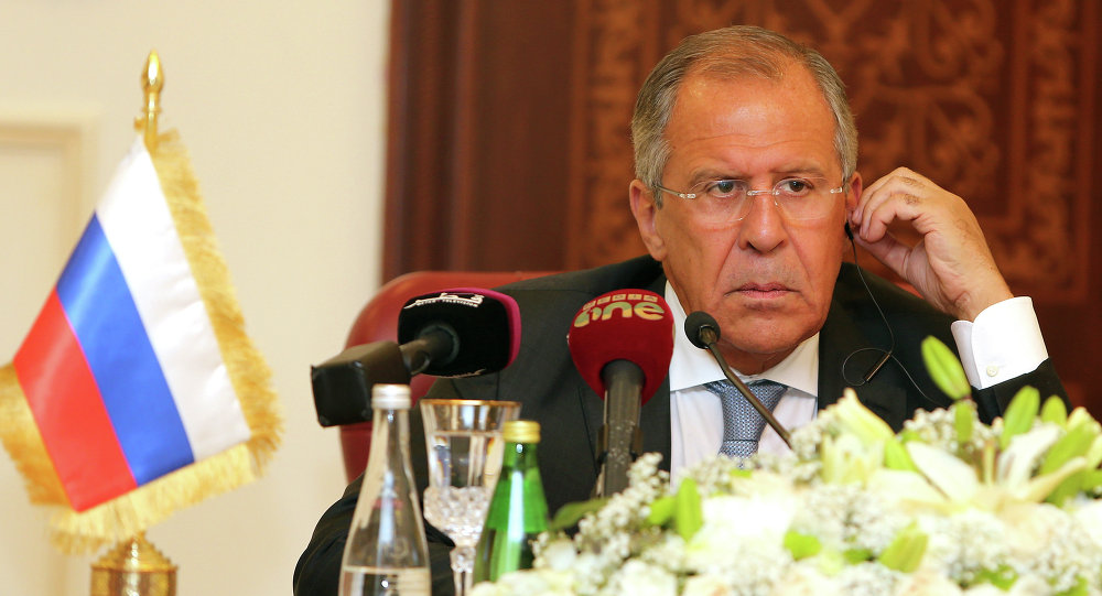 Russia's Foreign Minister Sergey Lavrov listens during a joint press conference with Qatari Foreign Minister Khalid bin Mohammad Al-Attiyah (unseen) on August 3, 2015 in Doha
