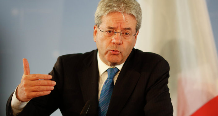 Italian Foreign Minister Paolo Gentiloni attends a news conference with his German counterpart Frank-Walter Steinmeier after a meeting at the foreign ministry in Berlin, Germany, Wednesday, June 17, 2015