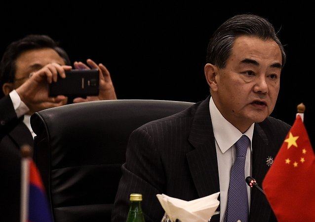 Chinese Foreign minister Wang Yi addresses the China ministerial meeting during the 48th Association of Southeast Asian Nations (ASEAN) Foreign Ministers meeting at the Putra World Trade Centre in Kuala Lumpur.