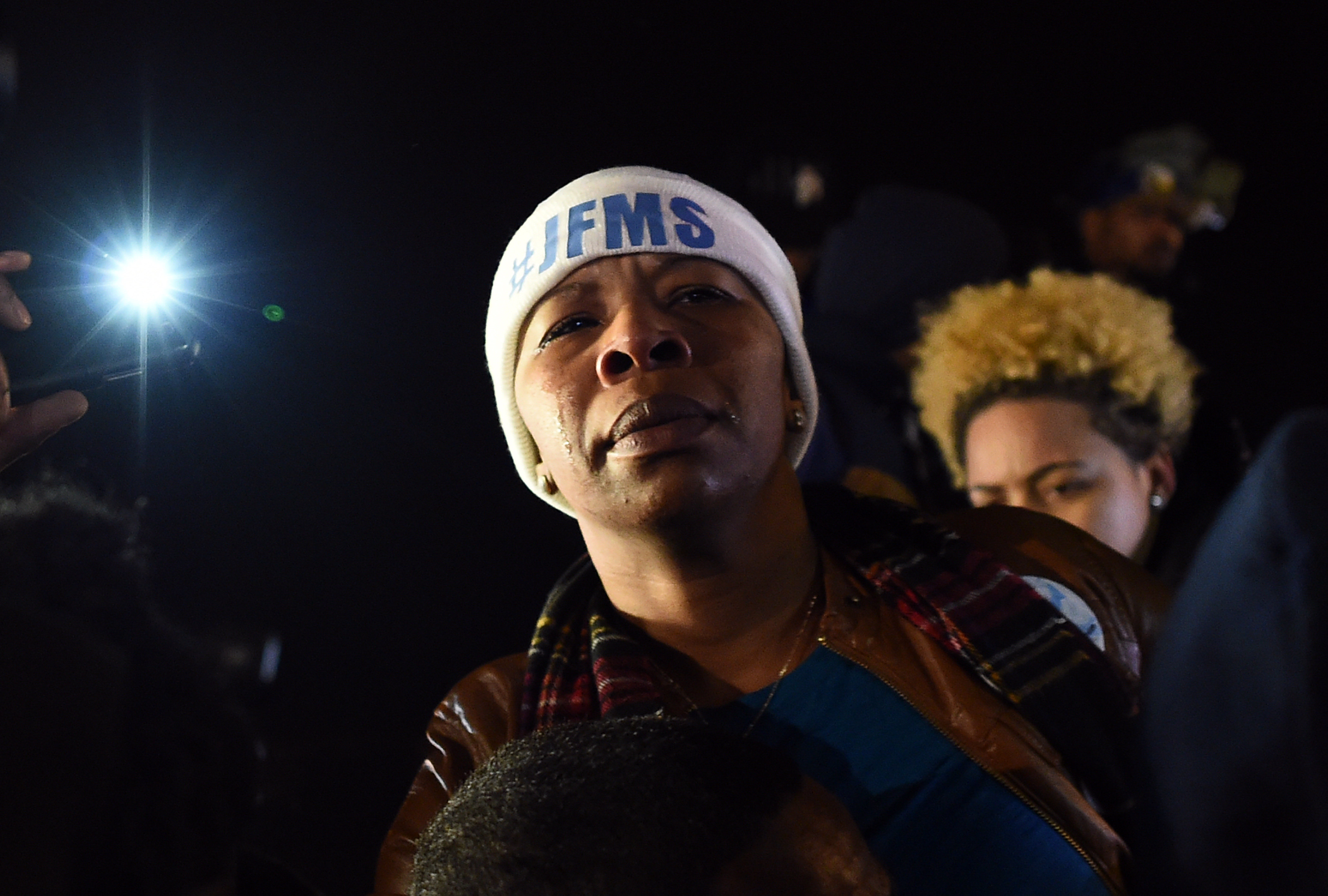 Michael Brown's mother Leslie McSpadden cries outside the police station in Ferguson, Missouri
