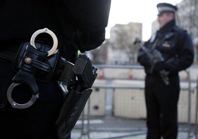 Armed policemen stand guard in Grosvenor Square in London. File photo