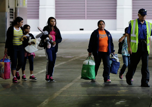 FILE - In this July 7, 2015, file photo, immigrants from El Salvador and Guatemala who entered the country illegally board a bus after they were released from a family detention center in San Antonio