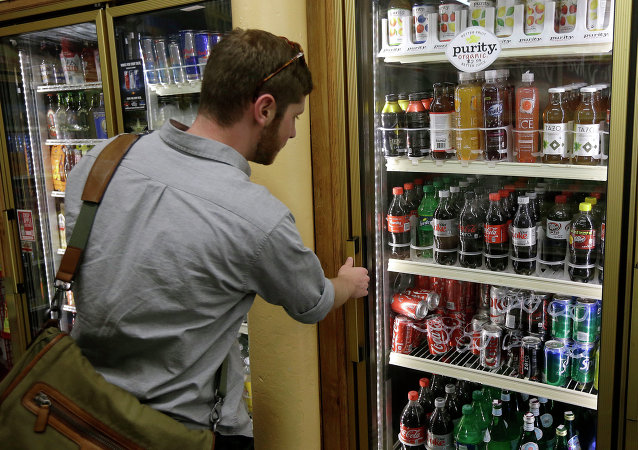 Ezra, last name not given, looks at the soft drink selection at K & D Market in San Francisco, Wednesday, Oct. 1, 2014