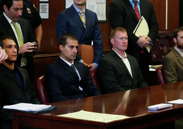 (L to R seated) Andrew Rossig, Marco Markovich, James Brady and Kyle Hartwell appear in Manhattan Criminal Court in New York May 6, 2014