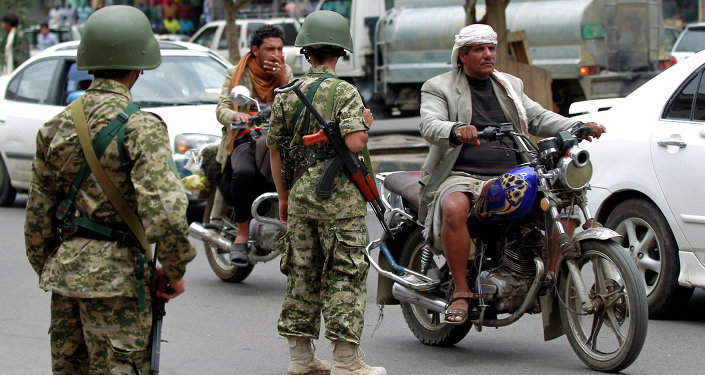 Yemeni soldiers, loyal to the Huthi Shiite militia, patrol vehicles in a street in the capital Sanaa, on May 25, 2015