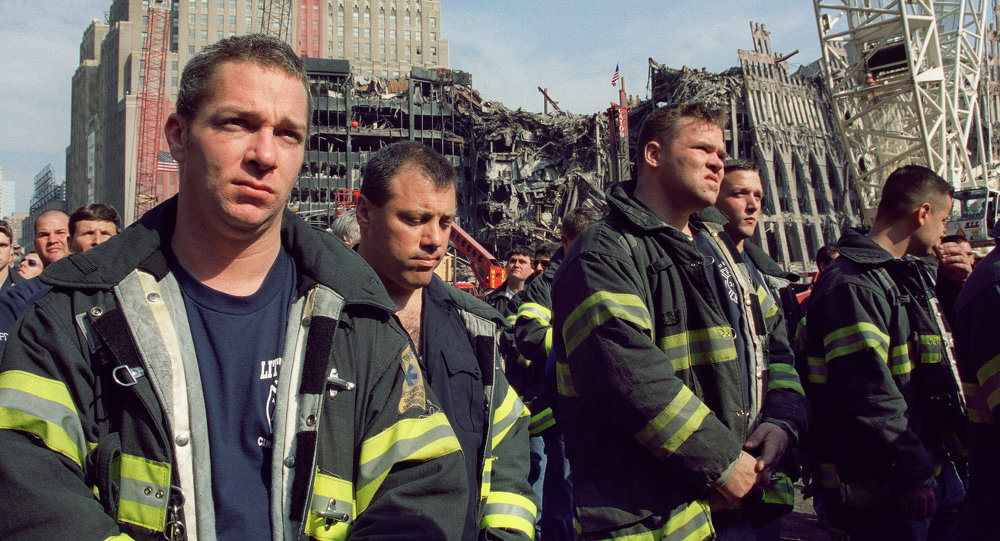 New York City firefighters stand at Ground Zero in New York.