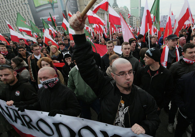 Right wing protesters wave flags at the start of the Independence Day march organized by nationalist parties, in Warsaw, Poland, Tuesday, Nov. 11, 2014