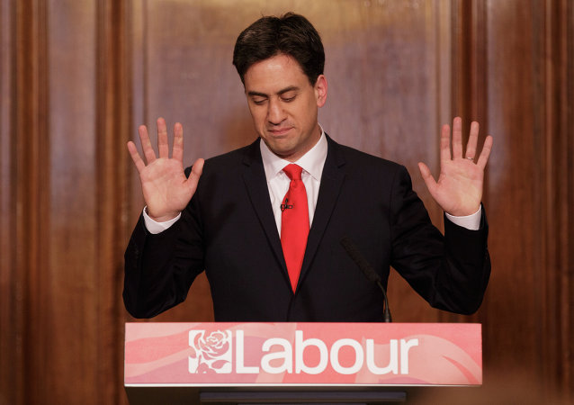 Britain's Labour Party leader Ed Miliband holds up his hands as he delivers his resignation at a press conference in Westminster, London, Friday, May 8, 2015
