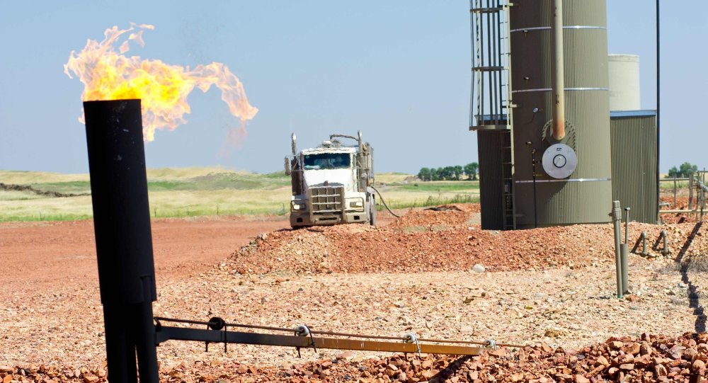 Photo taken August 19, 2013 shows natural gas burning off at an oil well site near Tioga, North Dakota