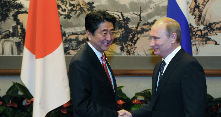 Russian President Vladimir Putin, right, and Japanese Prime Minister Shinzo Abe at their meeting held on the sidelines of the Asia-Pacific Economic Cooperation (APEC) summit in Beijing, November 9, 2014