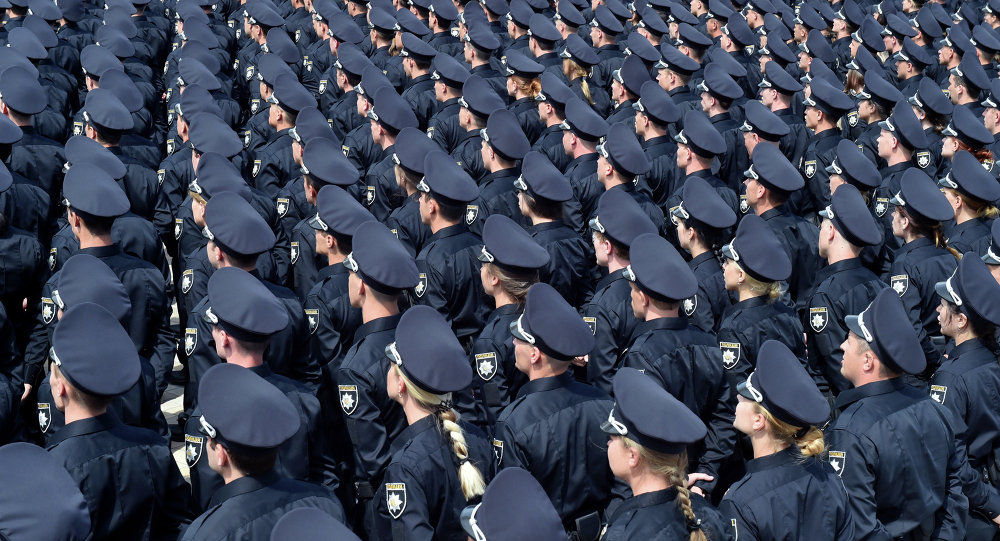 Police officers attend an official swearing-in ceremony in Kiev on July 4, 2015