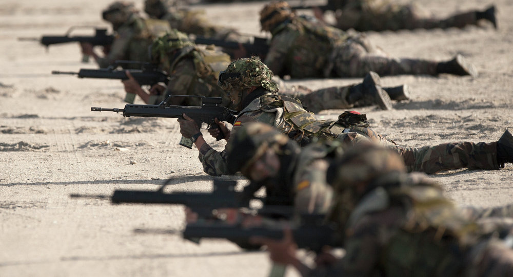 Spanish Navy Marines take positions during a military exercise in the Garrucha beach near Almeria, Spain. File photo